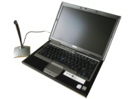 an iSolutions UDE laptop with a usb microphone